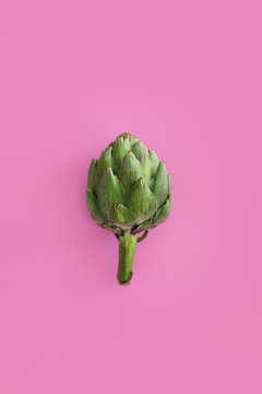 Colorful artichokes on color paper background