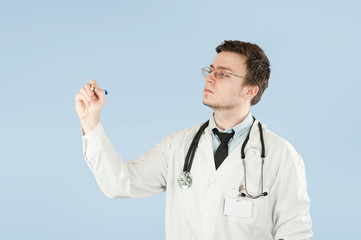 male doctor, medical worker, shows on empty space on isolated on blue background. Concept holds something in empty hand
