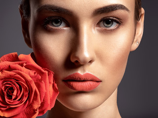 Beautiful young fashion woman with living coral color lipstick.