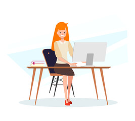 Business woman working with a computer at office desk.
