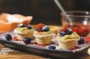 tart stuffed with cream, berries and jam of fresh strawberries