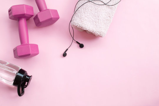 Female sport equipment on a pink background