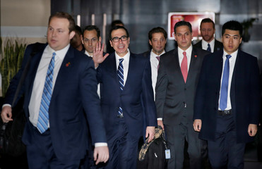 U.S. Treasury Secretary Steven Mnuchin waves to the media as he and members of the U.S. trade delegation to China leave a hotel in Beijing