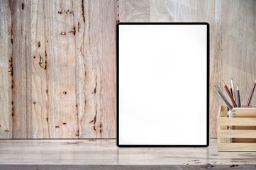 Mockup blank screen tablet on wooden table with copyspace for product display.