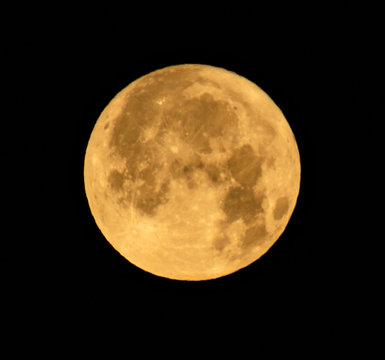 yellow moon on black sky
