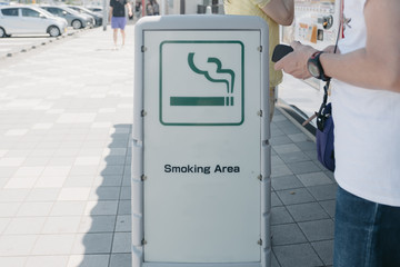 Sign of smoking area in the city