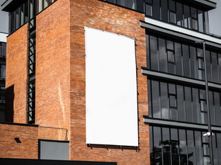 University, company office building facade, Blank white paper board at grunge brick red wall texture background, Mock up ads template, Business presentation content concept.