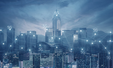 Technology 5G connectivities in the city multiple exposure.