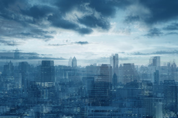 Abstract background multiple exposure of city skyline in blue tone.