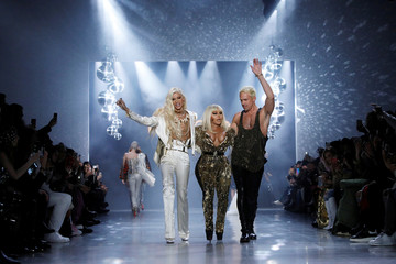 Musician Lil' Kim (C) walks the runway with designer Phillipe Blond (L) and creative director David Blond at The Blonds Autumn/Winter 2019 collection presentation during New York Fashion Week in New York