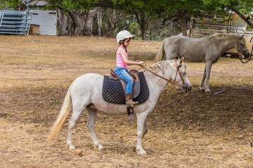 Young child learning to ride in the Upper Hunter Valley, NSW, Australia.