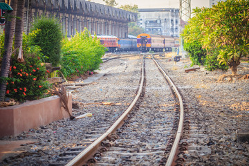 Bangkok, Thailand - April 23, 2017: Perspective railway landscape of free and empty railway lines. Detailed picture of rails and sleepers at Hua Lamphog railway station in Bangkok, Thailand.