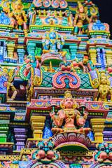 Poster Graffiti Colorful night view of indian gods sculpture at Sri Maha Mariamman Temple, also known as Maha Uma Devi temple, the public hindu temple in Silom, Bangkok, Thailand. It known as Wat Khaek Silom.