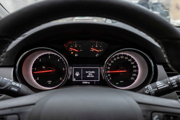 Car front instrument panel with warning of slippery roads.
