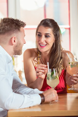 Young couple enjoying cocktails