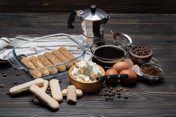 Ingredients for making traditional italian cake tiramisu on wooden table