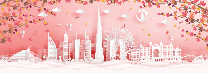 Wall Mural - Autumn in Dubai with falling maple leaves and world famous landmarks in paper cut style vector illustration