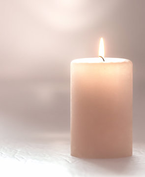 3d rendering. Burning candle pastel brown, soft blurred focus.
