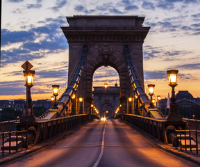 Fotobehang Brug Illuminated bridge and the road on the chain bridge in the morning in Budapest