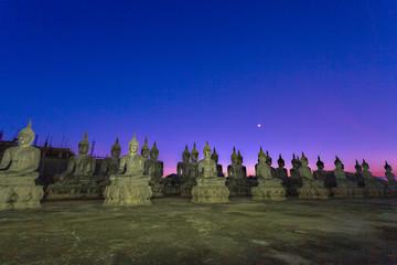 a lot of Buddha statues in twilight at  Tungsong Nakornsrithammarat