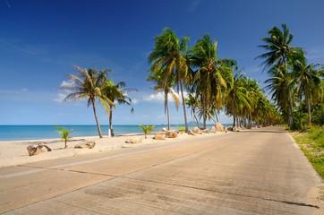 Scenic concrete road along paradise Ban Krut beach at Bang Saphan district of Prachuap Khiri Khan province of Thailand
