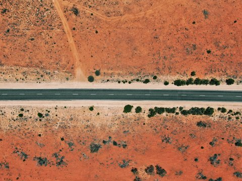 Rare paved road in the australian outback near Ayers Rock / Uluru