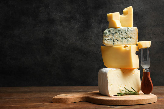 Cheese platter with rosemary and fork