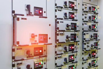 Electrical switch gear ,Digital meter at Low Voltage motor control center cabinet  in coal power plant. blurred for background.