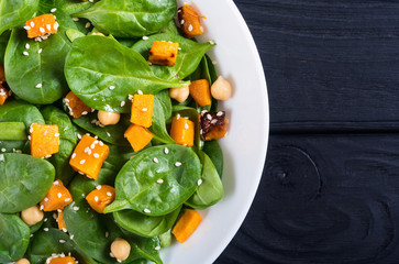 autumn salad with pumpkin , spinach , chickpea and sesame
