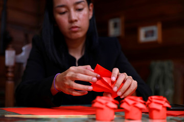 Filipino lawyer and entrepreneur Alex Castro makes origami flowers to be sold ahead of Valentines Day