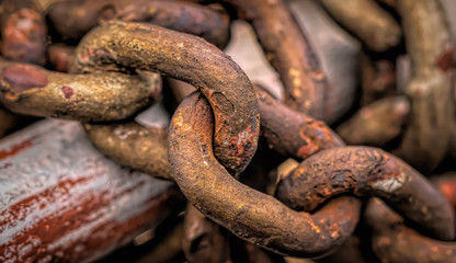 iron chain weighs on the pipe as a background for designers and artists