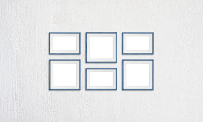 Frames collage, six blue realistic wooden frameworks isolated on white plastered wall