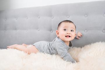 cute happy baby portrait lying on fur
