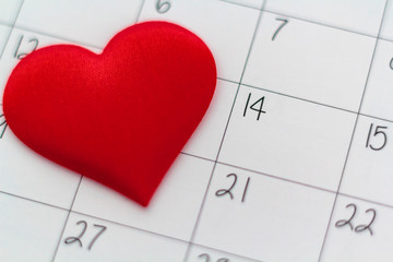 Calendar sheet with14th february date and red heart. Valentines day concept