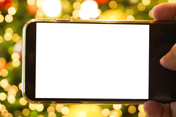 Smartphone with blank screen and Christmas background.