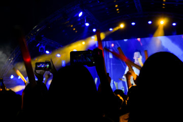 People are taking pictures concert with smartphones, Crowd at concert.