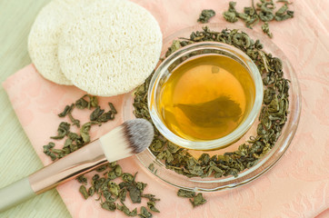 Homemade green tea face toner. Diy cosmetics recipe. Natural beauty treatment. Top view, copy space.