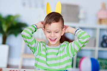 Playful boy with bunny ears