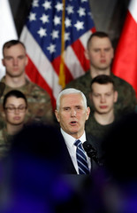 U.S. Vice President Mike Pence speaks during his arrival at the airport in Warsaw
