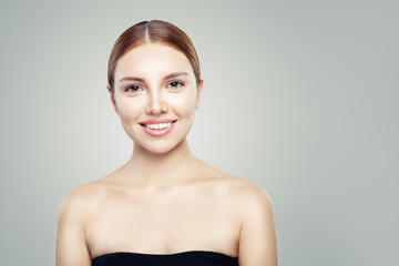 Smiling woman with healthy skin. Young perfect model face. Facial treatment, skincare and cosmetology concept.