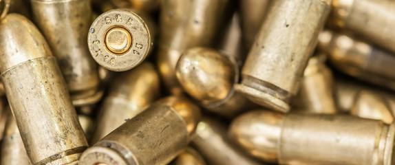 Top close-up macro view of large group of gun bullets