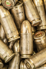 Top close-up macro view of large group of gun bullets