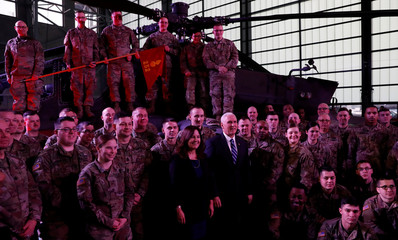 U.S. Vice President Mike Pence and his wife Karen pose for a photograph with U.S. army soldiers after his arrival at the airport in Warsaw