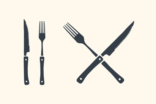 Meat cutting knives and forks set. Steak, butcher and BBQ supplies