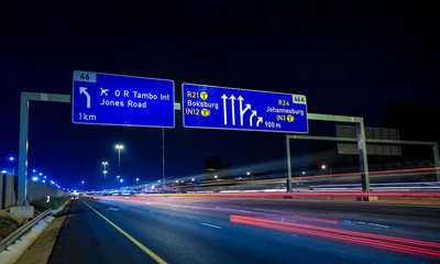 Spoed Foto op Canvas Nacht snelweg Motorway Signs on Highway at night