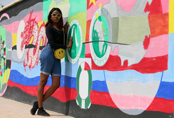 Mercy Emejuru, 23-year-old model and young voter, poses for a picture in Abuja