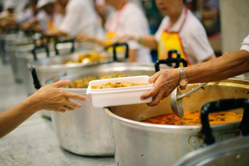 Volunteers have been feeding the homeless, They reach out with love and concern.