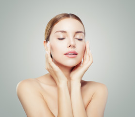Pretty woman with closed eyes  and young healthy skin. Facial treatment, face lifting, anti aging and skin care concept.