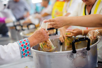 Volunteers serving food for poor people : Food sharing concept
