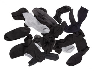 many scattered male socks isolated on white background, lost second sock